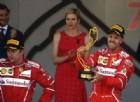I due volti della doppietta Ferrari: Sebastian Vettel trionfante, Kimi Raikkonen imbufalito
