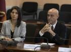 La sindaca Raggi e il ministro dell'Interno Marco Minniti durante il comitato per l'ordine pubblico e la sicurezza su Ostia tenuto lo scorso novembre