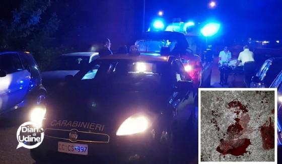 I carabinieri sul luogo dell'agguato e, nel riquadro, le chiazze di sangue lasciate sull'asfalto (© Diario di Udine)