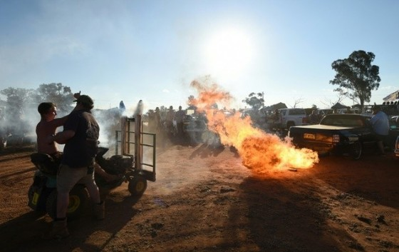 A modified pick-up truck fires flames from its exhaust pipes before a «Bachelor and Spinster» ball in the town of Ariah Park in western New South Wales