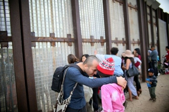 Six families passed through a gate in the US-Mexico border fence to greet relatives in an event organized by advocacy group Border Angels with US authorities to mark UN Children's Day