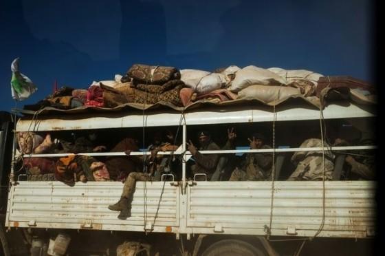 Militia from Iraq's Hashd Al Shaabi (Popular Mobilisation Units) on a truck on their way to Tal Afar airport