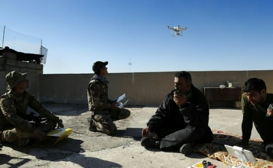 Iraqi government forces as well as Islamic State (IS) group jihadists already use drones for reconnaissance mission, such as these government forces looking for IS fighters hiding themselves in Mosul as they secure the area on November 22, 2016