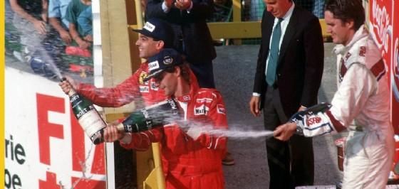 Michele Alboreto con l'altro ferrarista Gerhard Berger sul podio del GP d'Italia 1988 (© Ercole Colombo)