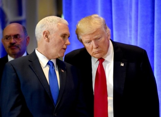 US President-elect Donald Trump (R) and Vice President-elect Mike Pence talk during press conference on January 11, 2017 at Trump Tower in New York