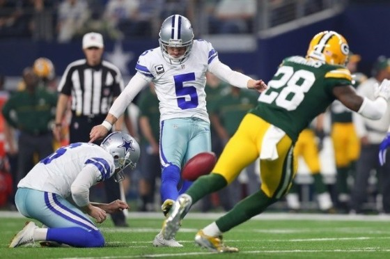 Dan Bailey of the Dallas Cowboys kicks a field goal during the second quarter against the Green Bay Packers, at AT&T Stadium in Arlington, Texas, on January 15, 2017