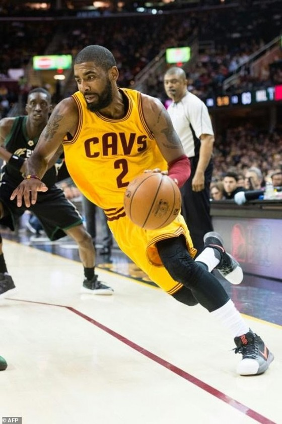 Kyrie Irving of the Cleveland Cavaliers drives past Tony Snell of the Milwaukee Bucks during the second half, at Quicken Loans Arena in Cleveland, Ohio, on February 27, 2017
