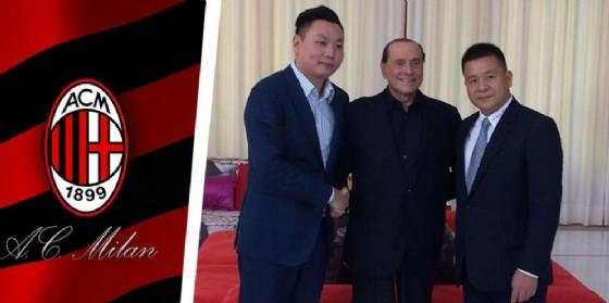 Il famoso trio closing: Berlusconi, Han Li e Yonghong Li (© ANSA)