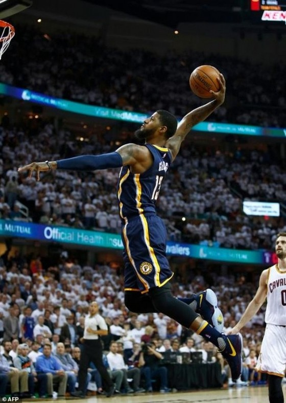 Paul George of the Indiana Pacers goes in for a dunk in front of Kevin Love of the Cleveland Cavaliers in Game Two of the Eastern Conference quarter-finals during the 2017 NBA Playoffs, at Quicken Loans Arena in Cleveland, Ohio, on April 17
