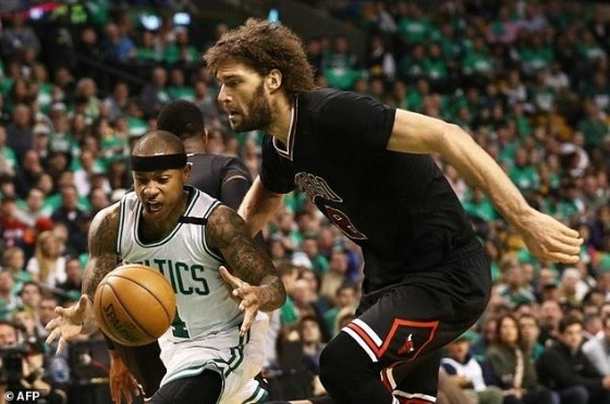 Isaiah Thomas (L) of the Boston Celtics and Robin Lopez of the Chicago Bulls fight for a loose ball in Game Two of the Eastern Conference quarter-finals, at TD Garden in Boston, Massachusetts, on April 18, 2017