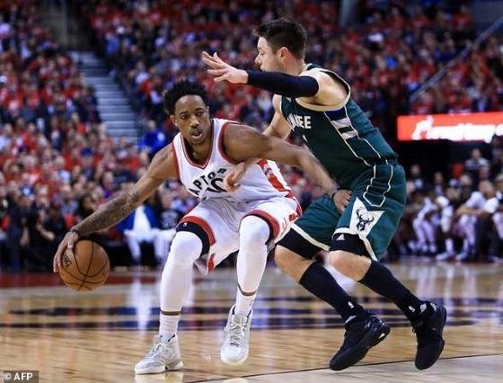 DeMar DeRozan of the Toronto Raptors dribbles the ball past Matthew Dellavedova of the Milwaukee Bucks in Game Two of the Eastern Conference quarter-finals, at Air Canada Centre in Toronto, Canada, on April 18, 2017
