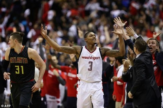 Bradley Beal of the Washington Wizards celebrates with head coach Scott Brooks in their 109-101 win over the Hawks in Game Two of the Eastern Conference Quarterfinals
