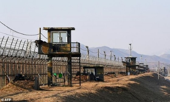South Korean guard posts along a heavily fortified border fence marking the Demilitarized Zone dividing the two Koreas