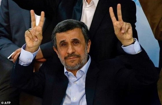 Former Iranian president Mahmoud Ahmadinejad flashes the sign for victory at the Interior Ministry's election headquarters as candidates begin to sign up for the upcoming presidential elections in Tehran on April 12, 2017