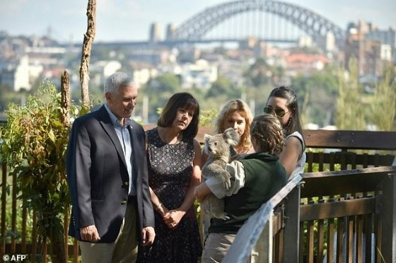 (L-R) US Vice President Mike Pence, his wife Karen, and their daughters Charlotte and Audrey visit the Taronga Park Zoo in Sydney on April 23, 2017 during the vice president's three-day tour in Australia