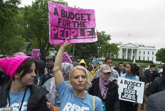 Protestors rally against US President Donald Trump's budget and agenda at Lafayette Park outside the White House on April 25, 2017