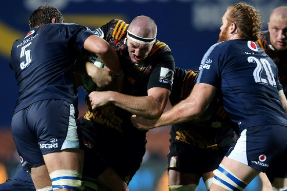 The Waikato Chiefs' Brodie Retallick (C) is tackled by the Northern Bulls' Lood De Jager (L) and Jannes Kirsten during their Super Rugby match, at FMG Stadium in Hamilton, on April 1, 2017