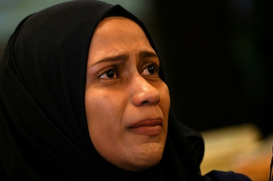 """I am begging the Malaysian government and police not to deport him,"" Ainnurul Aisyah Yunos said of her husband at a news conference on the outskirts of Kuala Lumpur"