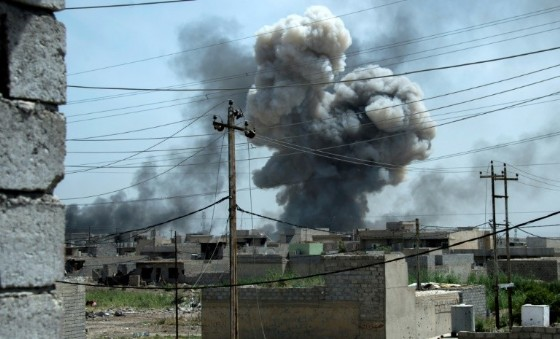 Smoke billows after a reported air strike on the northwestern Al-Haramat neighbourhood of Mosul on May 9, 2017