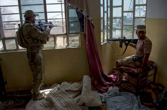 Members of the Iraqi forces guard a position in the northwestern al-Haramat neighbourhood of Mosul on May 9, 2017