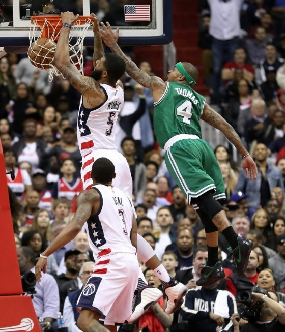 Markieff Morris of the Washington Wizards dunks against Isaiah Thomas of the Boston Celtics during Game Six of the Eastern Conference Semifinals