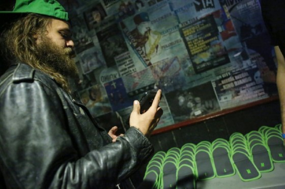 A member of the audience checks his phone before it is placed in a secure bag before attending a Lights Out concert at The Knitting Factory in Brooklyn New York on May 12, 2017
