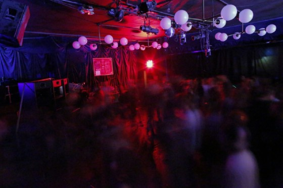 People dance during a Lights Out concert at The Knitting Factory in Brooklyn New York on May 12, 2017