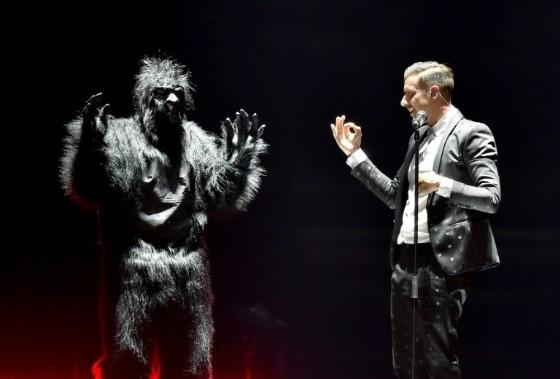 Italian singer Francesco Gabbani performs with a gorilla-costumed dancer