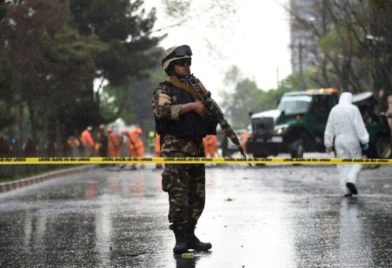 An Afghan soldier stands guard at the site of a suicide attack that targeted a foreign forces convoy near the US embassy in Kabul