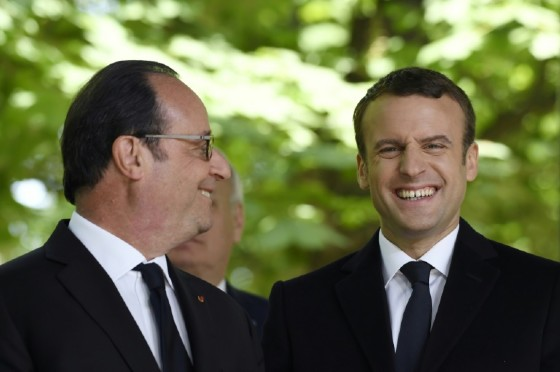 French President Francois Hollande (L) and newly elected president Emmanuel Macron attend a ceremony to mark the anniversary of the abolition of slavery, at the Jardins du Luxembourg in Paris, on May 10, 2017