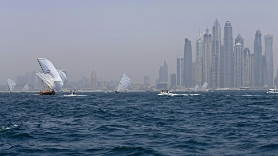 Dhows participate in the Al-Gaffal traditional long-distance dhow sailing race near the finish line off of Dubai on May 14, 2017