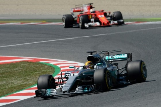 Mercedes' British driver Lewis Hamilton (bottom) and Ferrari's German driver Sebastian Vettel drive at the Circuit de Catalunya on May 14, 2017 in Montmelo on the outskirts of Barcelona during the Spanish Formula One Grand Prix