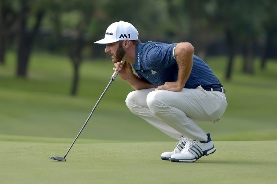 World number one Dustin Johnson of the US lines up a putt on the 16th green during round one of the AT&T Byron Nelson, at the TPC Four Seasons Resort Las Colinas in Irving, Texas, on May 18, 2017
