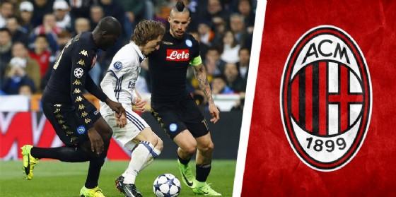 Luka Modric contrastato da Hamsik del Napoli