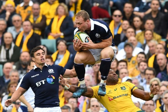 Scotland's Greig Tonks (C) grabs the ball in front of teammate Lee Jones and Australia's Tevita Kuridrani during their rugby union Test match in Sydney, on June 17, 2017