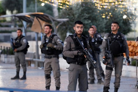 Israeli border guards stand outside Damascus Gate in Jerusalem's Old City on June 16, 2017 following an attack
