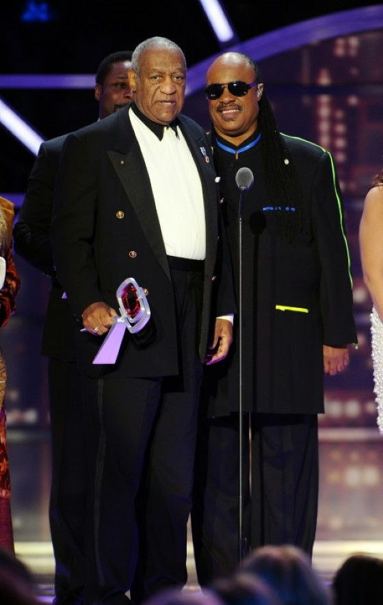"Cosby (L) won many awards over his career, including the TV Land Impact Award presented to ""The Cosby Show"" cast in 2011 in New York by musician Stevie Wonder"