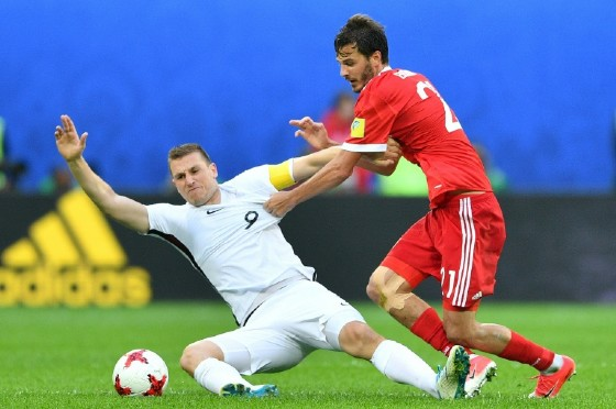 New Zealand's forward Chris Wood (L) is tackled by Russia's midfielder Alexander Erokhin during the 2017 Confederations Cup group A football match June 17, 2017