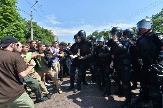 Ultra-nationalists clash with policemen as they try to prevent a gay pride event in Kiev, on June 18, 2017