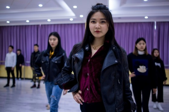 """Wang Xin, 20, switched from accounting to a major in wanghong -- social media stardom. """"I have always had an idea, a dream to be on stage with the lights on me and the crowd watching me,"""" she told AFP."""
