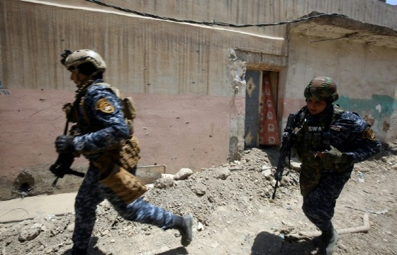 Iraqi forces advance on Mosul's Old City, the last neighbourhood of Iraq's second city still held by the Islamic State group, on June 18, 2017