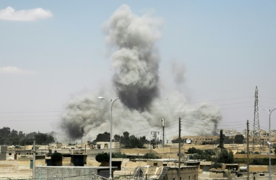 Smoke billows from buildings in the northern Syrian city of Raqa on June 18, 2017