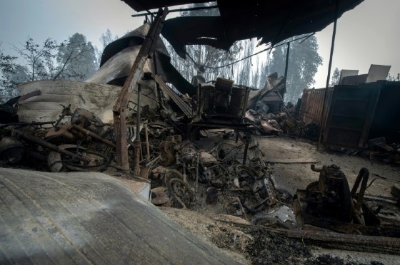 The wreckage of a garage in an area devastated by a wildfire close to the village of Figueiro dos Vinhos, where more than 1,000 firefighters are still trying to control the huge forest fire