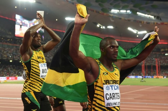 Jamaica's Usain Bolt (left) and Nesta Carter celebrate victory in the 4x100 metres relay at the 2015 World Championships in Beijing