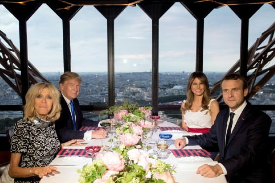 French President Emmanuel Macron (R), his wife Brigitte Macron (L), US President Donald Trump (2nd L) and First Lady Melania Trump (2nd R) dine at the prestigious Le Jules Verne Restaurant on the Eiffel Tower in Paris
