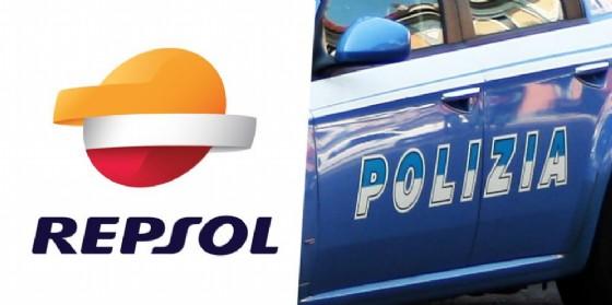 Il logo del distributore Repsol e una pattuglia della Polizia di Stato