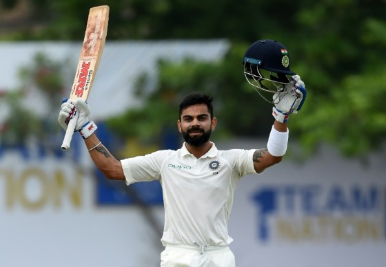 India captain Virat Kohli celebrates reaching his century during the fourth day of the first Test against Sri Lanka in Galle on July 29, 2017
