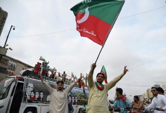 Supporters of opposition leader Imran Khan's Pakistan Tehreek-i-Insaf (PTI) celebrate after the Supreme Court decison against Pakistan's Prime Minister Nawaz Sharif near Khan's residence in Karachi