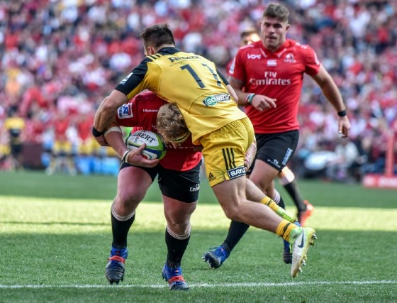 Jacques van Rooyen (L) of the Lions clashes with Wes Goosen of the Hurricanes during the Super Rugby semi-final match in Johannesburg