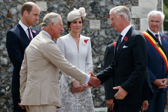 (From left) Britain's Prince Charles and King Philippe of Belgium shake hands as Britain's Princess Kate and Prince William look on during the commemorations at The Tyne Cot Commonwealth War Graves Cemetery in Zonnebeke on July 31, 2017